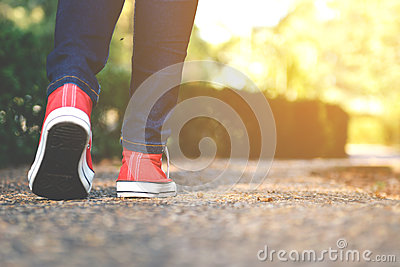 stock image of feet women in the walking on the park