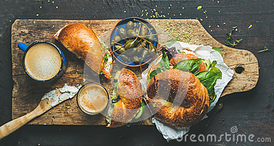 Breakfast with bagel, espresso coffee and capers in blue bowl