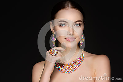 Beautiful woman in a necklace, earrings and ring. Model in jewel