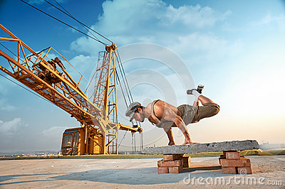 Athletic man doing exercise push ups on hands.