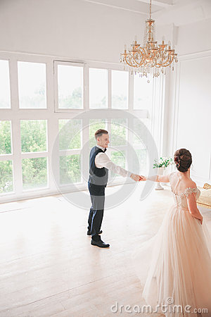 First wedding danc.wedding couple dances on the studio. Wedding day. Happy young bride and groom on their wedding day.