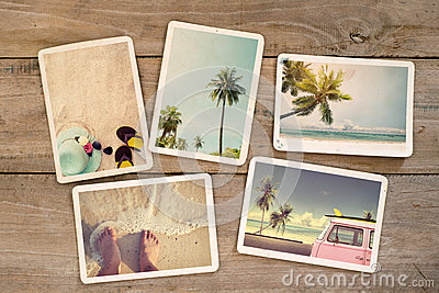 Photo album remembrance and nostalgia journey in summer surfing beach trip on wood table.
