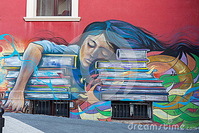 Beautiful street art graffiti. Abstract creative drawing fashion colors on the walls of the city. Urban Contemporary