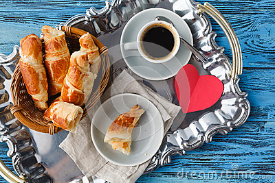 Valentines day breakfast with croissants and tea