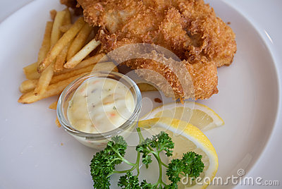 Fish and chips on white plate