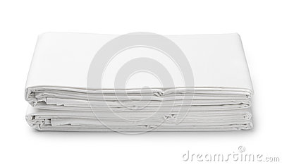 Stack of white folded bedding sheets