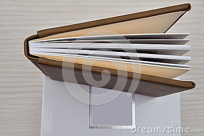 Top view of wedding, christening brown leather photo album ajar