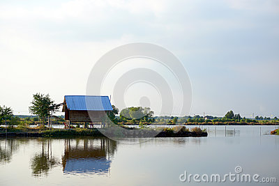Landscape lake with cottage house village. relaxation waterfront hut
