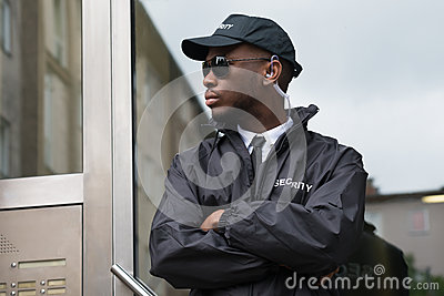 Security Guard Standing Arms Crossed
