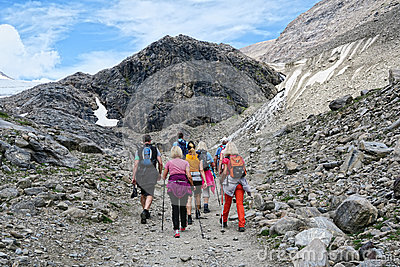 hiker walking along a path at Grossglockner Mountain and Pasterze in Austria. Summer.