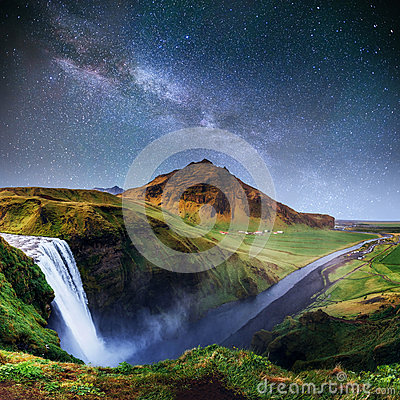 Beautiful waterfall. The starry sky and the Milky Way. Iceland.