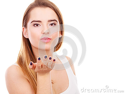 Teenager woman sending air kisses, love gesture