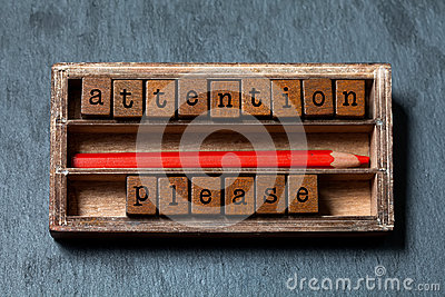 Attention please. Warning note and retro style caution banner concept. Vintage box, wooden cubes with old style letters