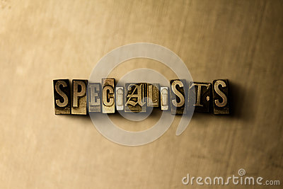 SPECIALISTS - close-up of grungy vintage typeset word on metal backdrop
