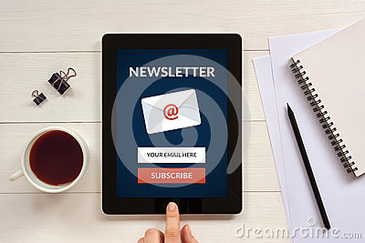Subscribe newsletter concept on tablet screen with office object