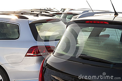Parked Cars on a Lot. Row of New Cars on the Car Dealer Parking