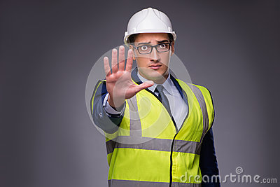 The man wearing hard hat and construction vest