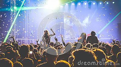Crowd of people dancing at night club - Live concert festival event