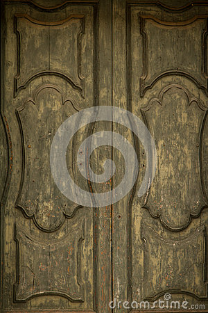 Antique olive green wooden hand decorated gate door texture background