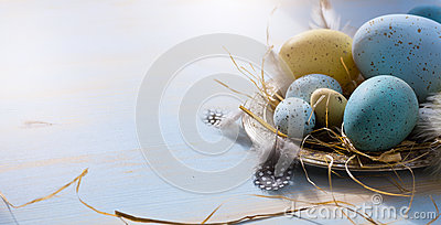 Happy Easter; Easter eggs on blue table background. Holidays vie