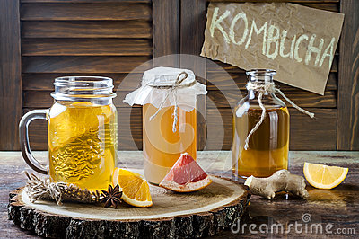 Homemade fermented raw kombucha tea with different flavorings. Healthy natural probiotic flavored drink. Copy space.