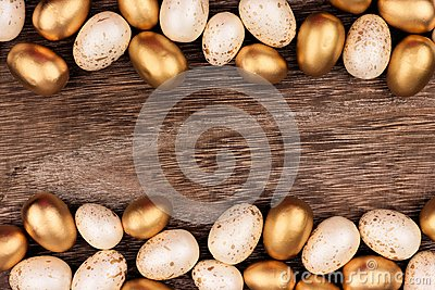 White and gold Easter egg double border over rustic wood