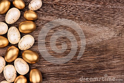 White and gold Easter egg side border over rustic wood