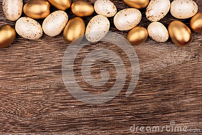White and gold Easter egg top border over rustic wood