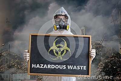 Ecology and pollution concept. Man in coveralls is warning against hazardous waste