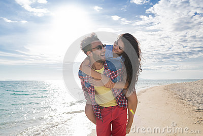 Young Couple On Beach Summer Vacation, Happy Smiling Man Carry Woman Back Seaside