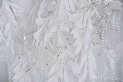 Textile background closeup. White drapery fabric flowers. Wedding texture, lace