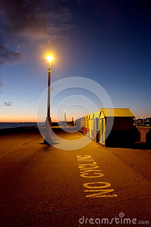 Brighton seafront, street lamp and beach huts at night  street l