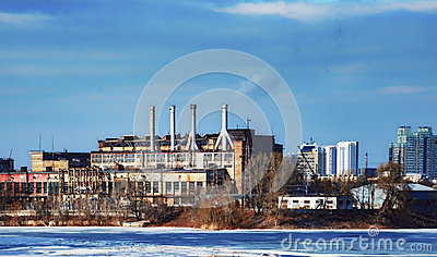 stock image of old working factory, near a water, day, outdoor