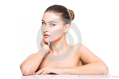 Beauty Portrait. Beautiful Spa Woman Touching her Face. Perfect Fresh Skin. Isolated on White Background. Pure Beauty