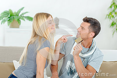 Couple fighting over possession credit card
