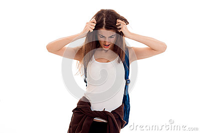 Tired young brunette students teenager in stylish clothes and backpack on her shoulders posing isolated on white