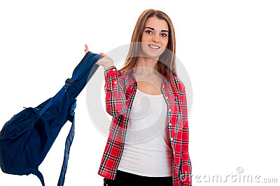 Beautiful young brunette students teenager in stylish clothes and backpack in hands posing isolated on white background