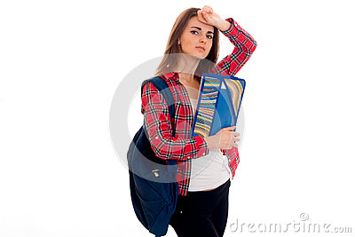 Lovely young brunette students teenager in stylish clothes and backpack on her shoulders posing isolated on white