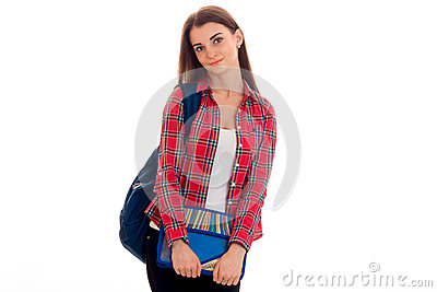 Cute young brunette students teenager in stylish clothes and backpack on her shoulders posing isolated on white
