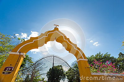 Yellow gate in Izamal, Mexico