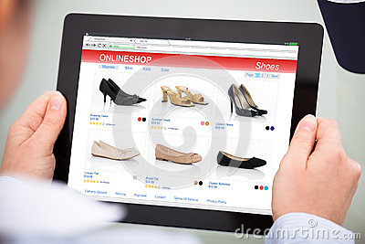 Person Doing Online Shopping On Digital Tablet