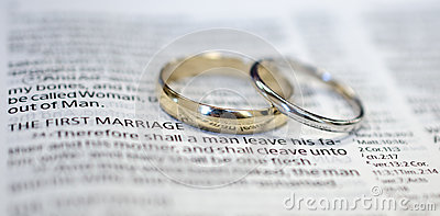 Wedding rings on Bible scripture