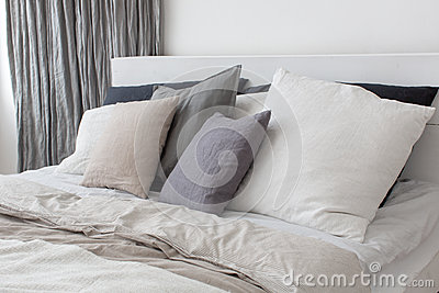 Bed with white and grey linens