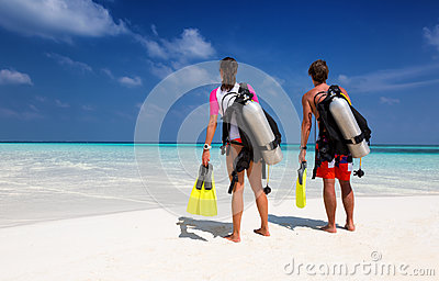 Young couple in scuba diving gear