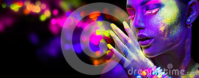 Woman in neon light, portrait of beautiful model with fluorescent makeup