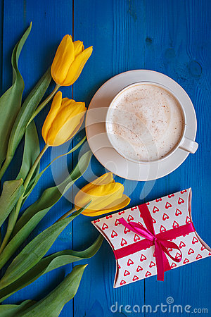 Coffee mug with yellow tulip flowers and gift