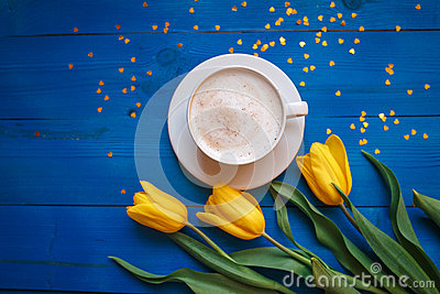 Coffee mug with yellow tulip flowers