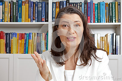Middle aged woman explaining library