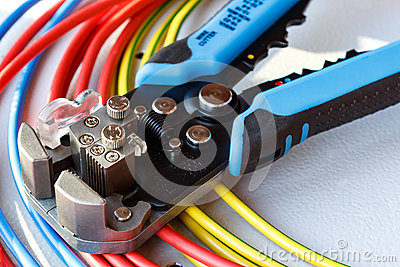 Wire stripper and cutter closeup with colored power cords
