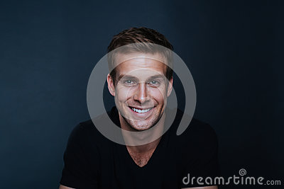 Portrait photo of young happy man with a blinding smile
